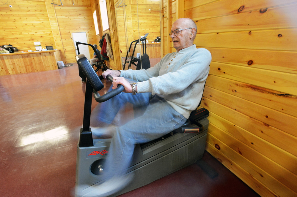 Mike Morris, 87, of Bingham, works out on the stationary bike at the New England Field Service Health Club on Owens Street in Bingham on Thursday. The health club, which opened in a renovated mill in January, is the town's first.