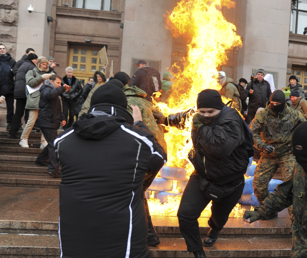 Heavy fighting in a separatist stronghold isn't the only problem facing Ukrainian leaders as protesters burn tires outside Kiev's city council building due to a fee hike.