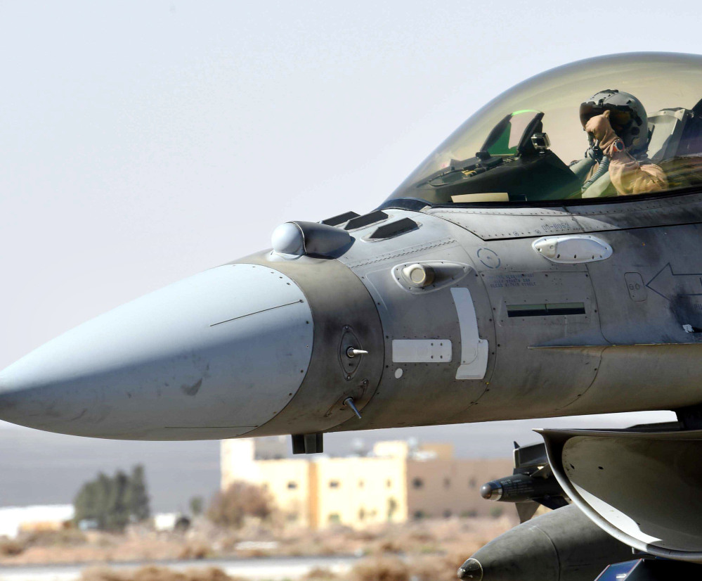 A United Arab Emirates pilot gets ready to launch an airstrike from Jordan on Tuesday.