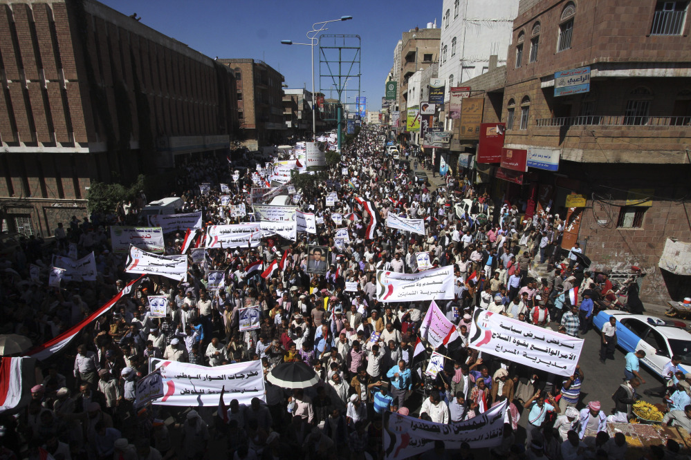 Yemeni demonstrators protest against Houthi Shiites who have seized power in the capital, Sanaa, while they celebrate the fourth anniversary of the uprising in Taiz, Yemen, on Wednesday.