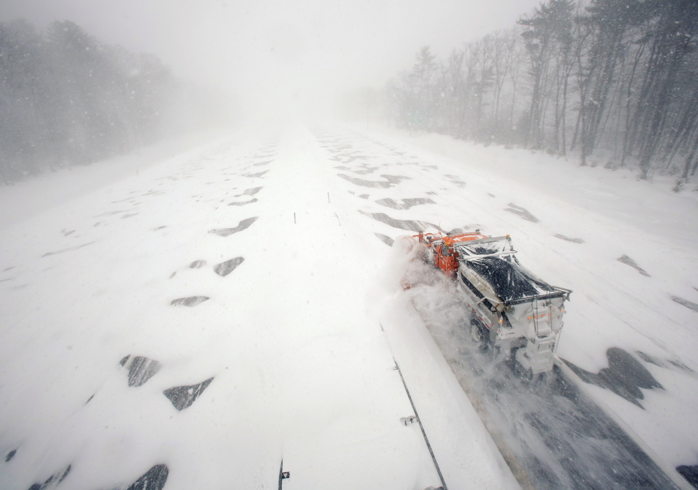 """A plow clears a northbound lane of the Maine Turnpike in Kennebunk during the Jan. 27 blizzard. """"We plan for winters like this,"""" said Peter Mills, the Maine Turnpike Authority's executive director."""