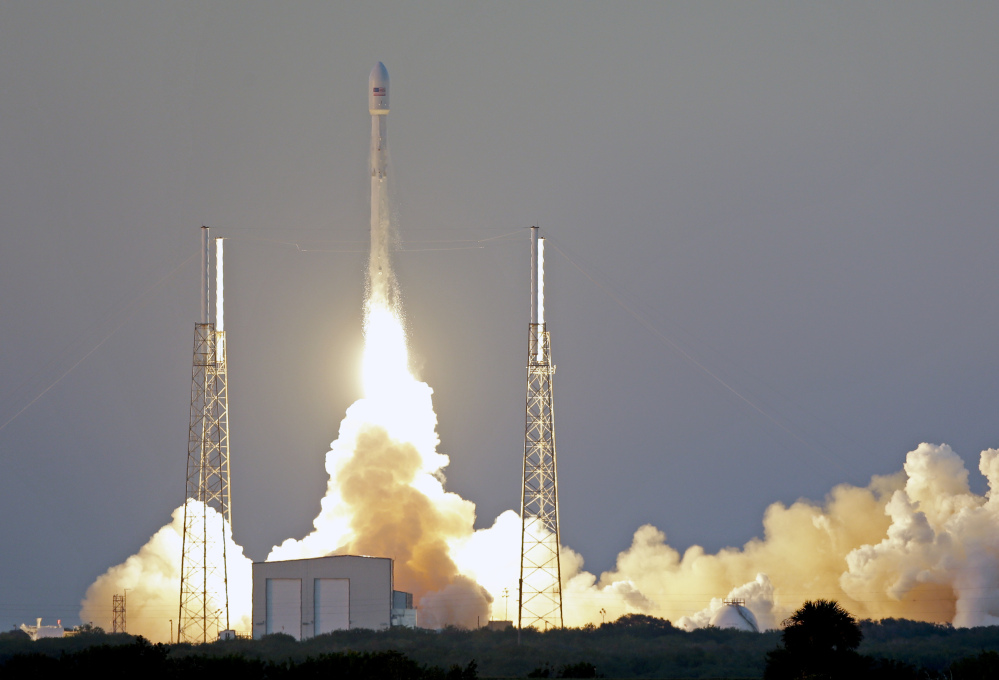 A Falcon 9 SpaceX rocket with a satellite to monitor solar storms lifts off from Cape Canaveral Wednesday evening.