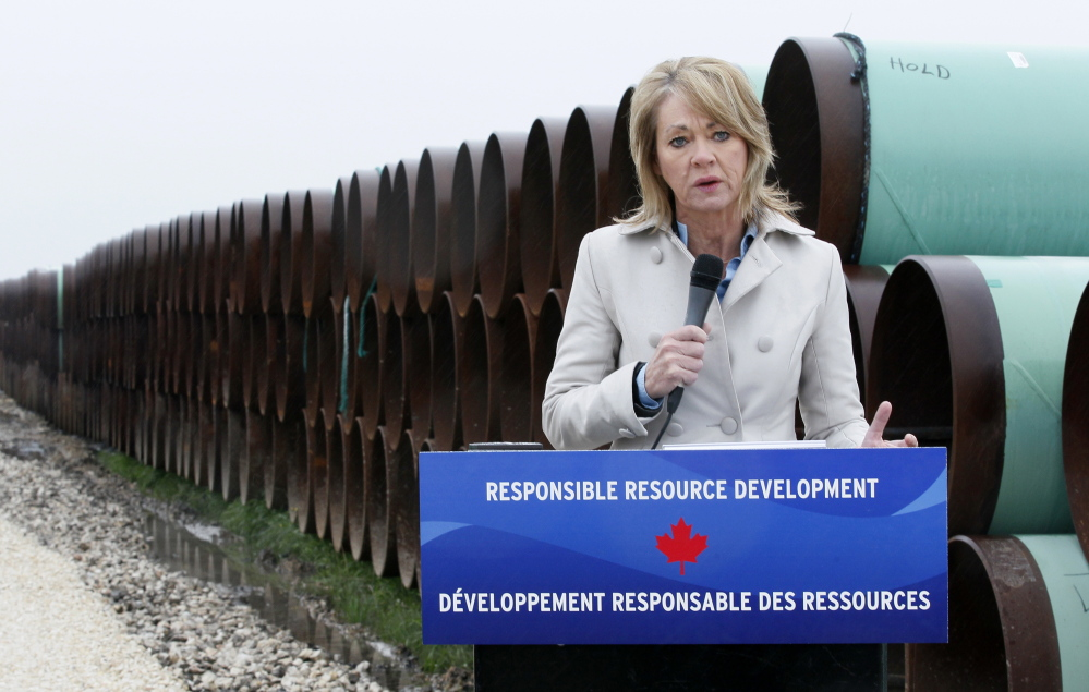 Diana McQueen, Alberta, Canada energy minister, speaks at the pipe yard for the Houston Lateral Project, a component of the Keystone pipeline system in Houston, Texas March 5, 2014.  REUTERS/Rick Wilking (UNITED STATES - Tags: BUSINESS ENERGY) - RTR3G2RG