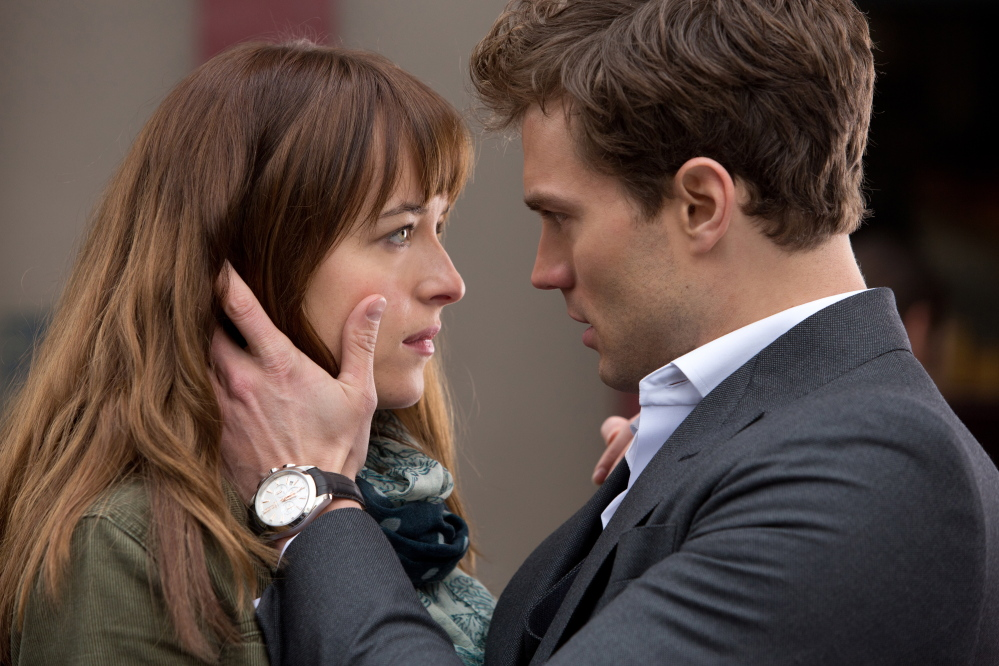 """Dakota Johnson, left, and Jamie Dornan appear in a scene from """"Fifty Shades of Grey."""""""