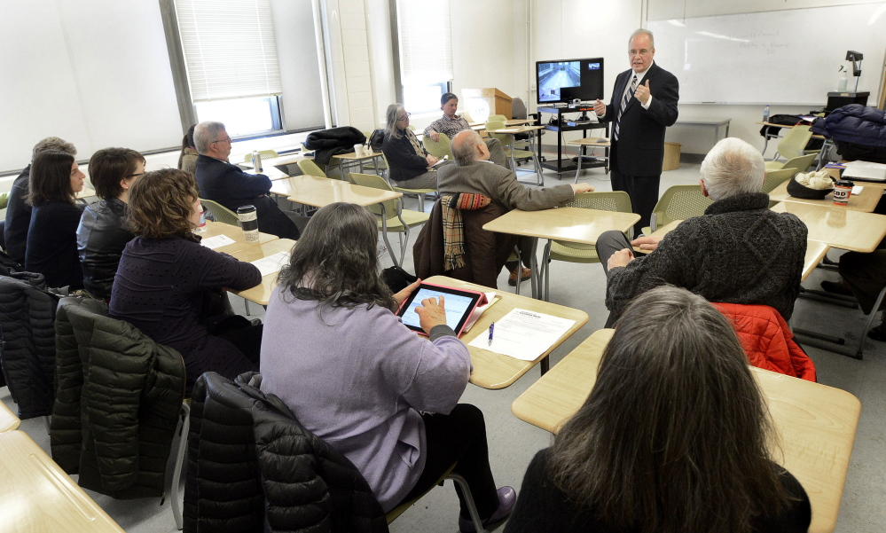 Harvey Kesselman, a finalist for the University of Southern Maine president's job, speaks to faculty members at Luther Bonney Hall in Portland on Thursday.