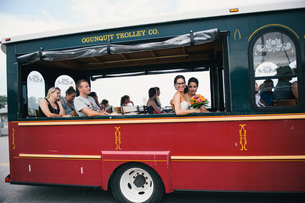"Jessica and Michelle Newton of Newton, Mass., ride a trolley back into downtown Ogunquit for dinner after they eloped together on a sailboat. ""(The town is) such a welcoming, friendly, down-to-earth place,"" Jessica Newton said."