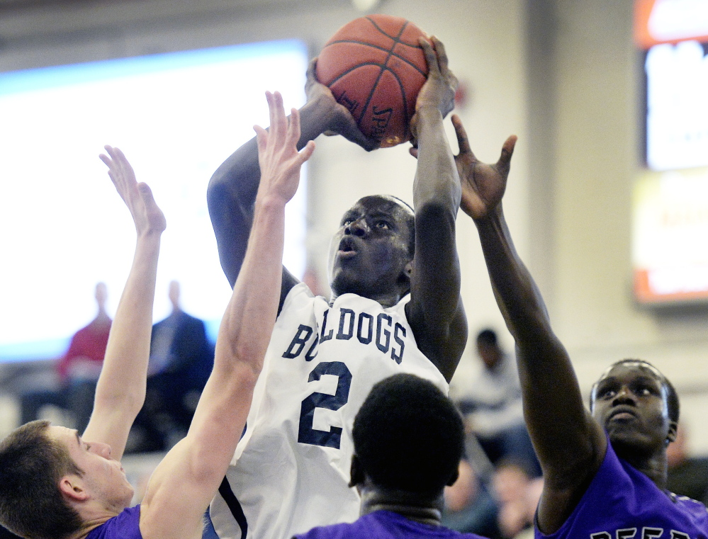 Portland's Stephen Alex shoots over a crowd of Deering defenders during their game on Jan. 15. Alex is averaging 17 points for the defending Class A state champions.