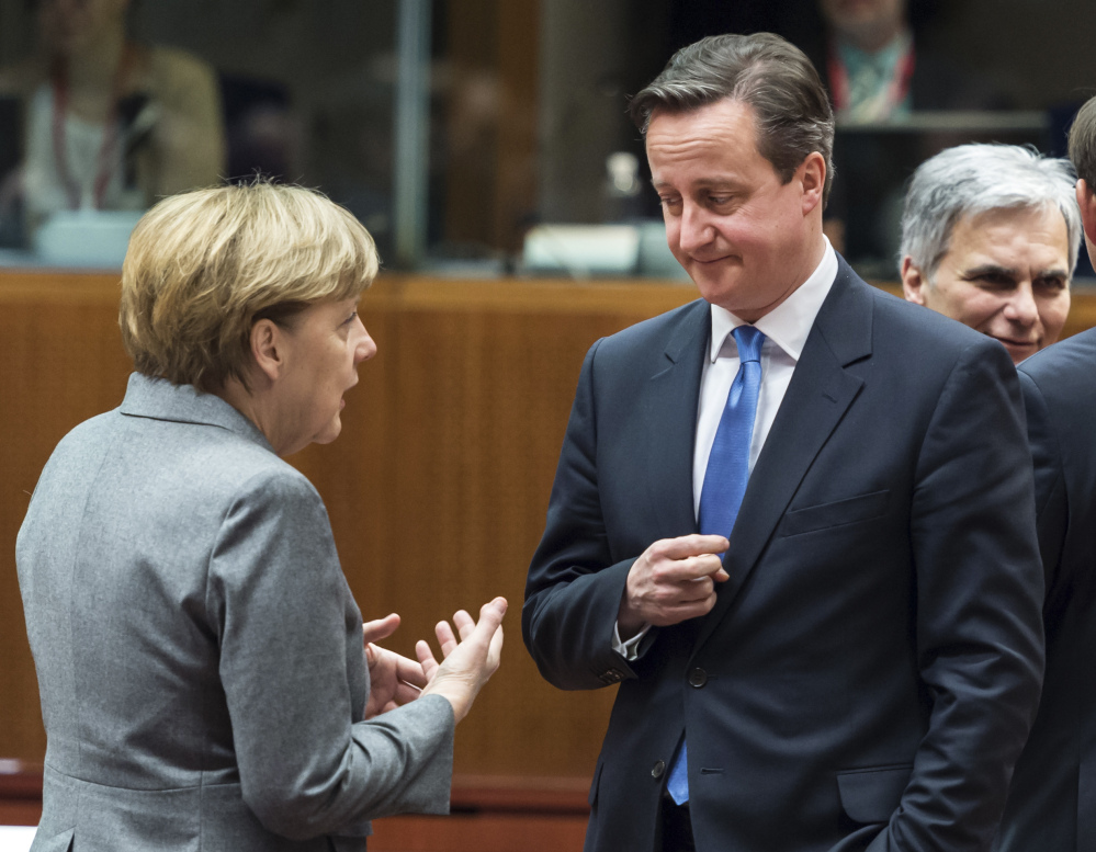 German Chancellor Angela Merkel discusses peace prospects with British Prime Minister David Cameron.
