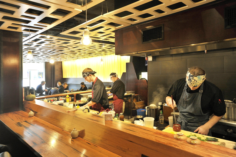 Miyake's team of chefs at work in the restaurant's open cooking area.