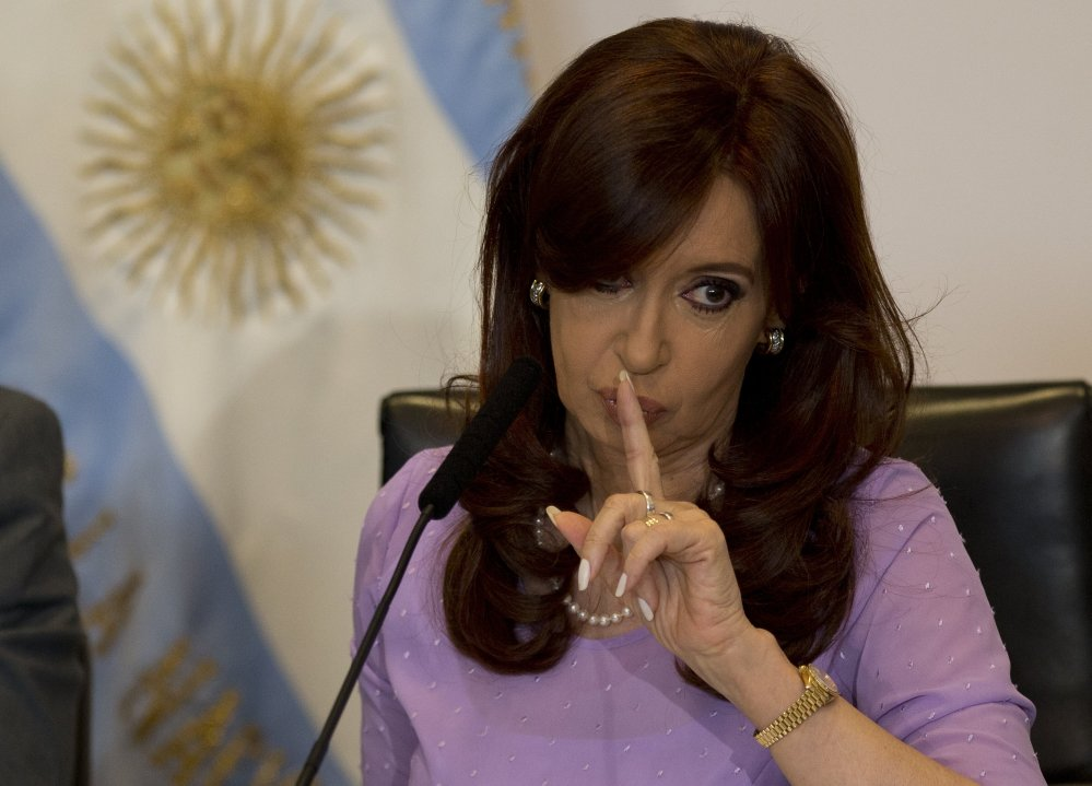 Argentina's President Cristina Fernandez signals to supporters during an event announcing new government projects in Buenos Aires, Argentina, on Wednesday.