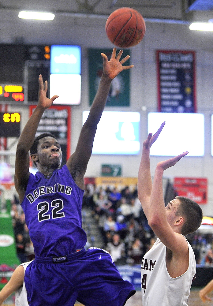 Free throws and a pivotal block made a huge difference Friday night as Ben Williams came up big for Deering. Williams puts up a jumper during the 61-59 victory against Gorham at the Expo.