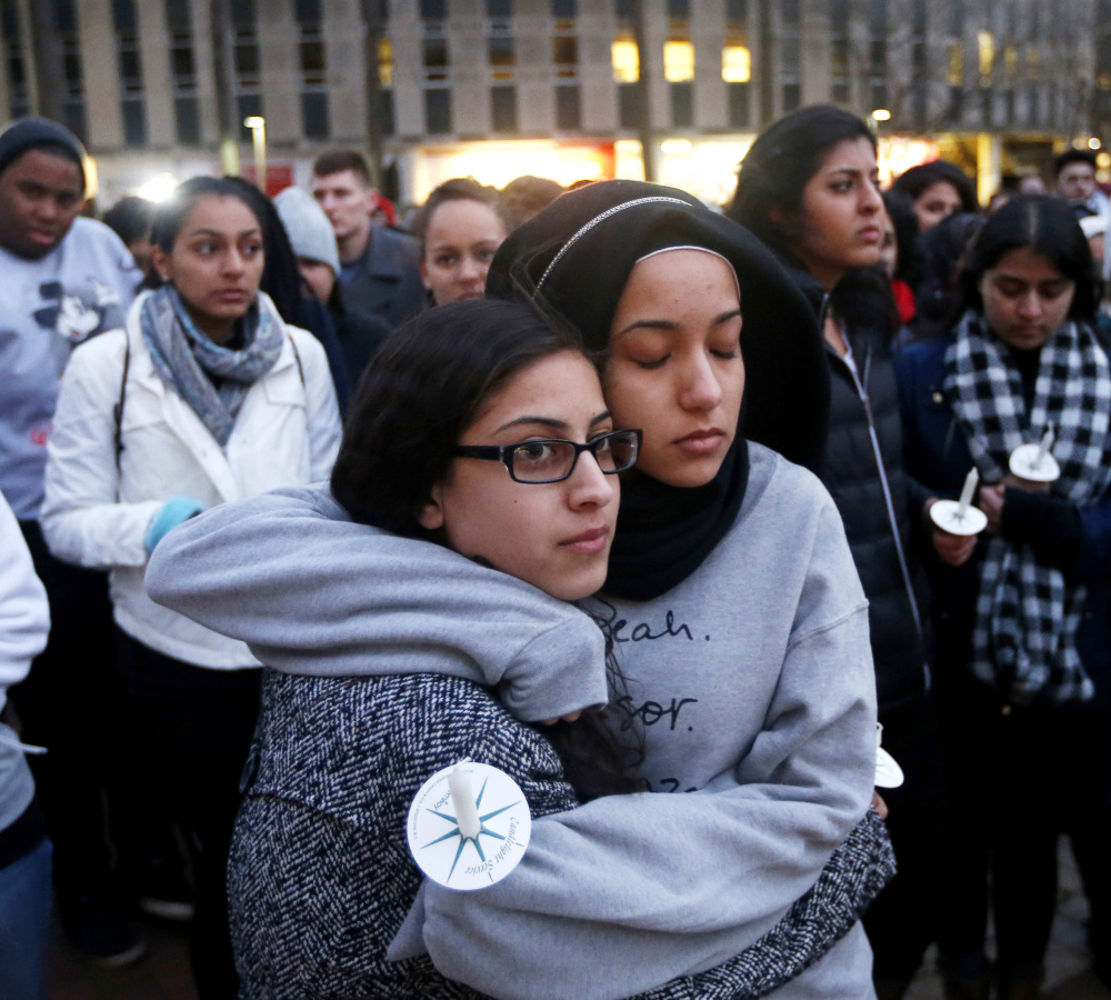 North Carolina State sophomore Firdaws Chahrour, right, hugs Danyah Dahbour before a vigil Thursday on the campus for three Muslim college students killed Tuesday.