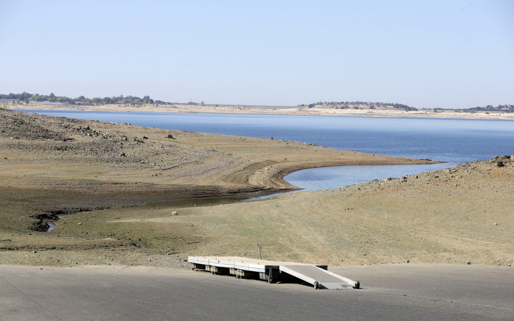 A dock sits high and dry at the end of a boat ramp yards away from the edge of Folsom Lake near Folsom, Calif., in October. Recent storms have eased California's decade-long drought somewhat, but state officials are worried that the rain will give people an excuse to abandon their already paltry conservation efforts.