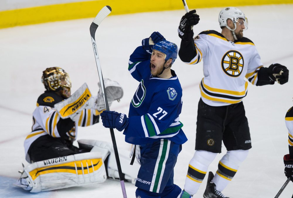 The Vancouver Canucks' Shawn Matthias (27) celebrates his third goal against Bruins goalie Tuukka Rask during the third period of Friday night's game in Vancouver, British Columbia.