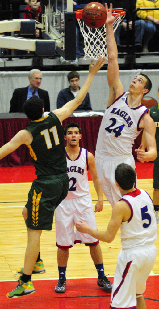 Messalonskee's Nick Mayo blocks a shot against Oxford Hills forward Tyus Ripley on Saturday at the Augusta Civic Center. Mayo finished with 31 points and 14 rebounds for the Eagles.