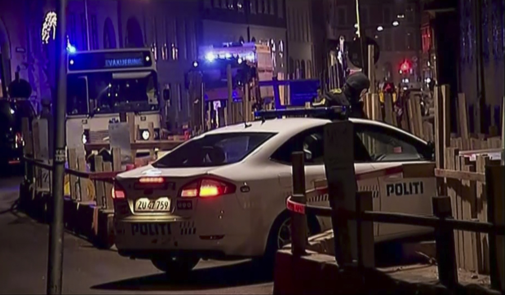 This image made from TV2 via Associated Press News video shows the scene near a synagogue where police reported a shooting in downtown Copenhagen, Denmark, Sunday.
