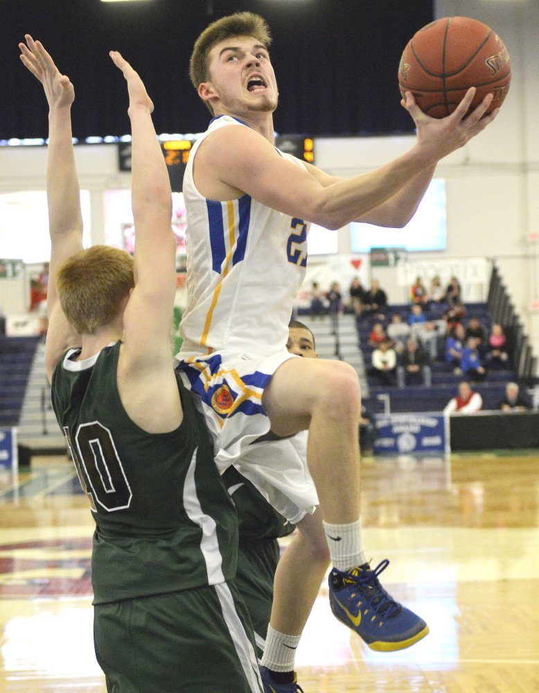 Quinn Piland of Lake Region heads to the basket Saturday while defended by Caulin Parker of Spruce Mountain during Lake Region's 41-37 victory in a Western Class B boys' basketball quarterfinal at the Portland Expo.