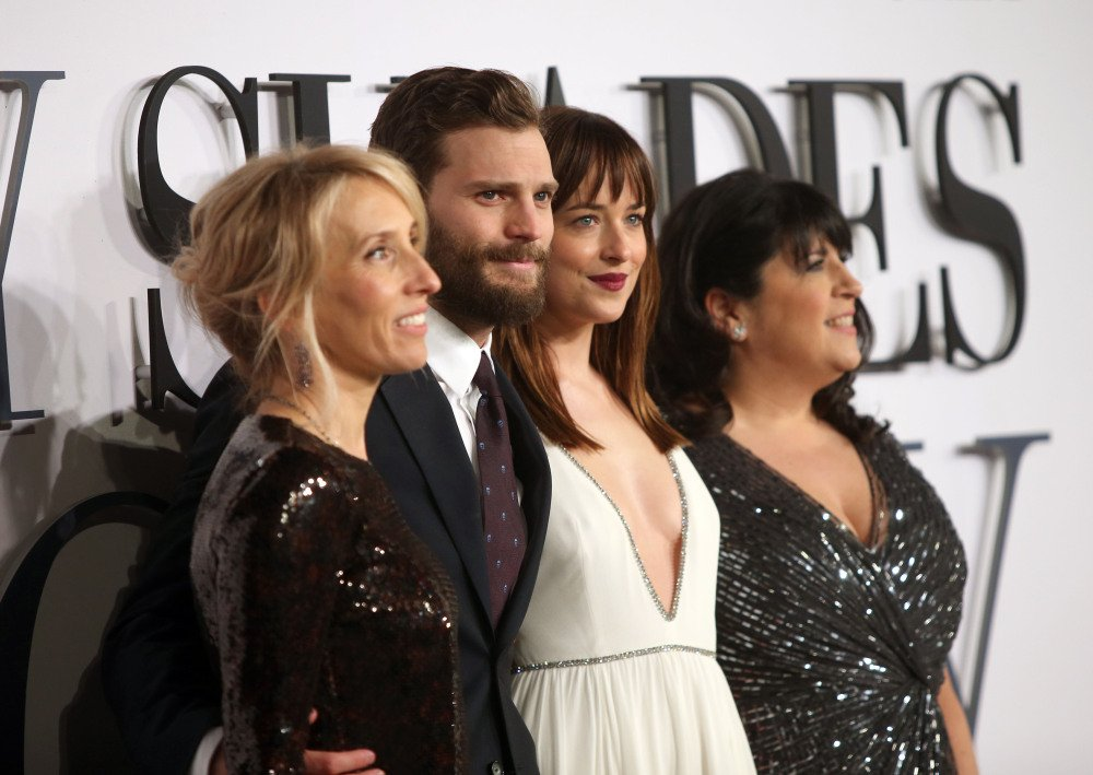 "Sam Taylor-Johnson, Jamie Dornan, Dakota Johnson and E.L. James arrive at the UK premiere of ""Fifty Shades of Grey"" Thursday."