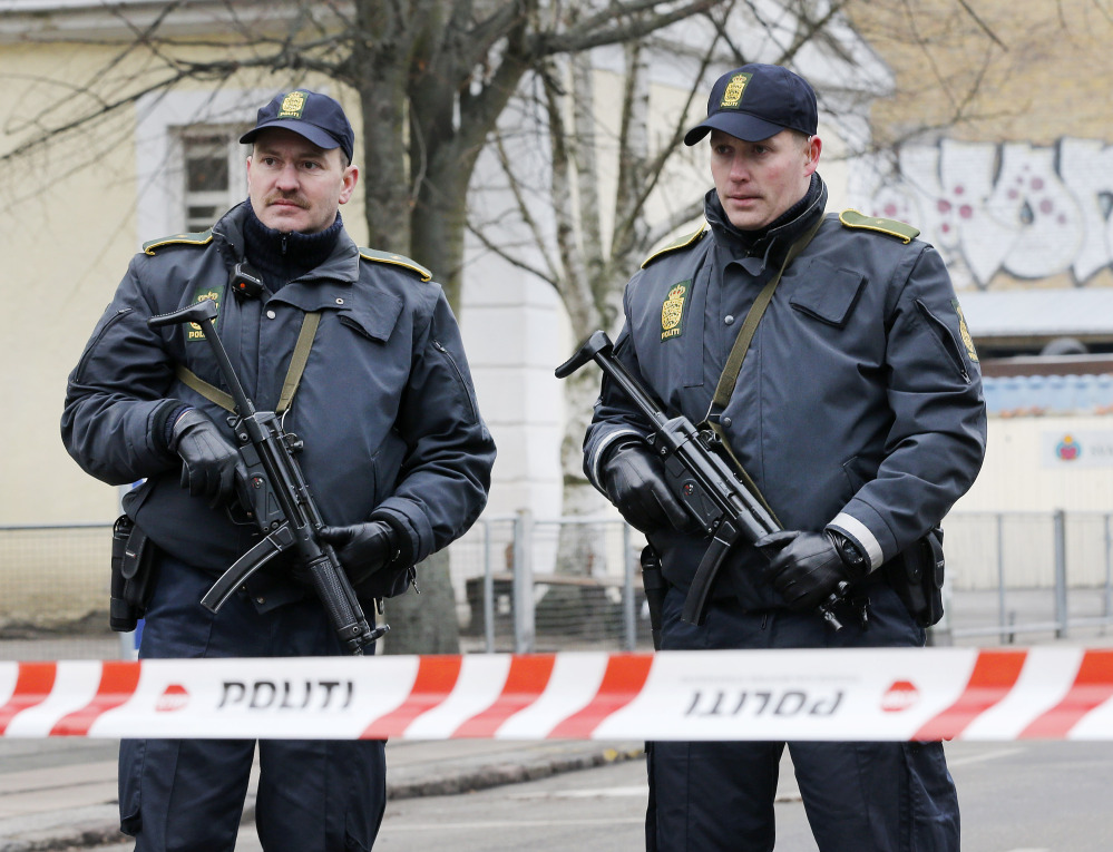 Danish police officers secure near to where a man was shot dead on Sunday in Copenhagen, Denmark. Danish police shot and killed a man early Sunday suspected of carrying out shooting attacks at a free speech event and then at a Copenhagen synagogue, killing two men, including a member of Denmark's Jewish community. Five police officers were also wounded in the attacks.