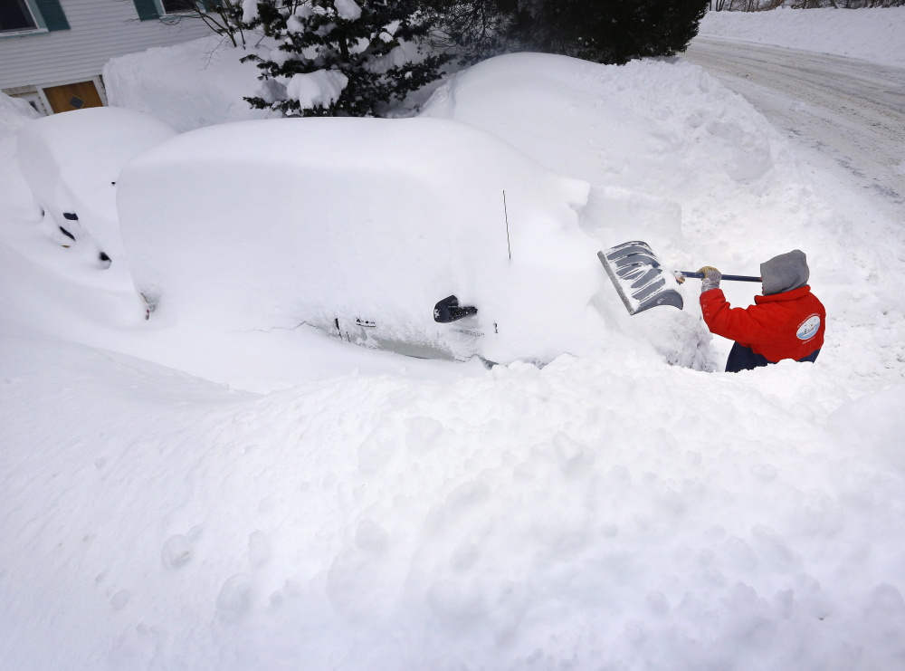 Rich Grafe of Kittery Point digs out his vehicles after a storm that left over a foot and a half of fresh snow in Kittery.
