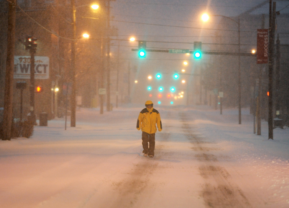 Ron Davis walks to a doctor's appointment early Monday in Bowling Green, Kentucky. Bitterly cold temperatures are expected to follow the snow, with lows below zero.