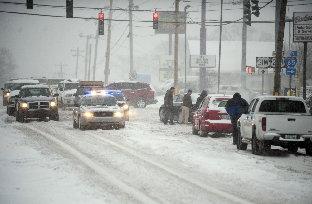 Law enforcement help stuck motorists Monday after several inches of snow fell in Bowling Green, Kentucky. The National Weather Service said anywhere from 6 to 15 inches of snow are possible by evening.