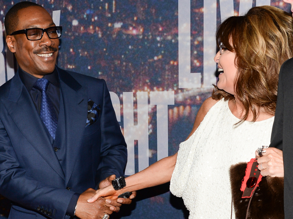 Actor Eddie Murphy and former Alaska Gov. Sarah Palin greet each other on the red carpet Sunday in New York.  The Associated Press