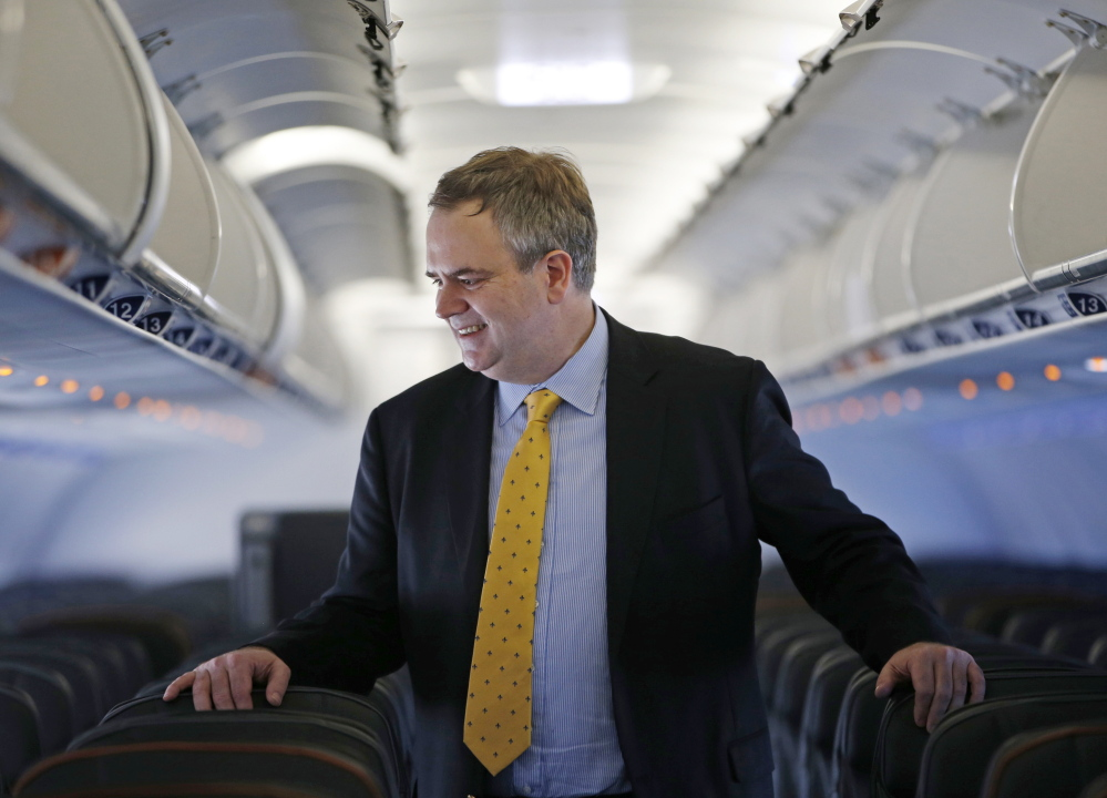 Robin Hayes, the new CEO of JetBlue, will try to boost the airline's earnings to be more in line with competitors. In the spring, the company will begin to charge for checked baggage.