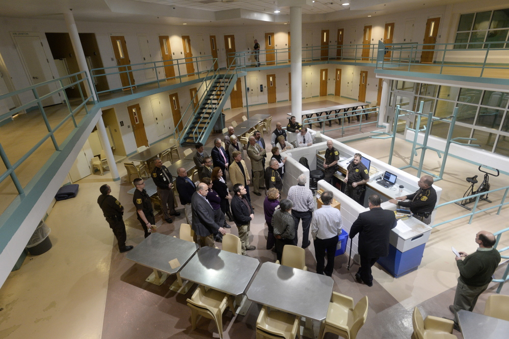 Legislators and county officials take a tour of a pod in the Cumberland County Jail in Portland in late January.