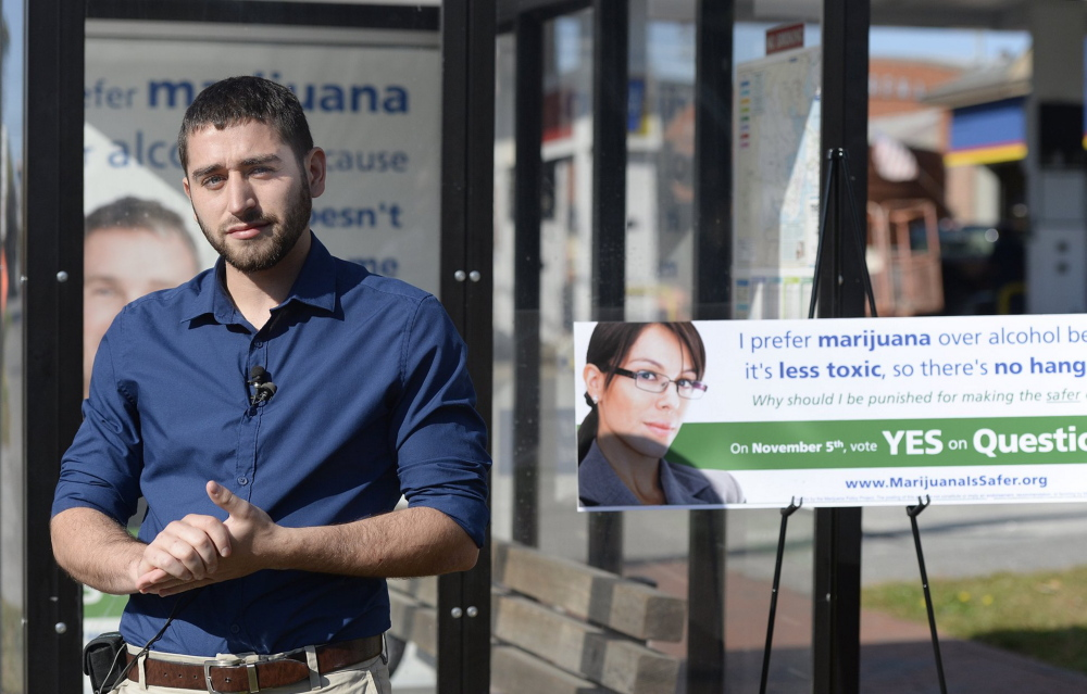Shawn Patrick Ouellette/Staff Photographer   David Boyer of the Marijuana Policy Project speaks with the press near a bus shelter on Park St. in Portland that displays one of the Ads in support of an initiative to remove penalties for marijuana possession  Wednesday, Oct.  02, 2013.