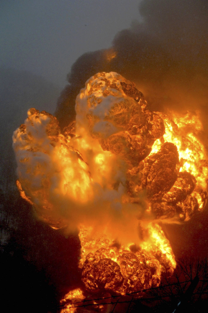 A fire burns Monday after a train derailment near Charleston, W.Va.