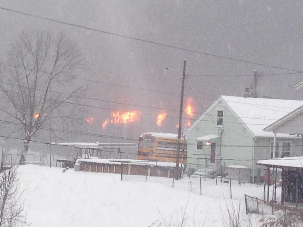 A fire burns Monday, after a train derailment near Charleston, W.Va.