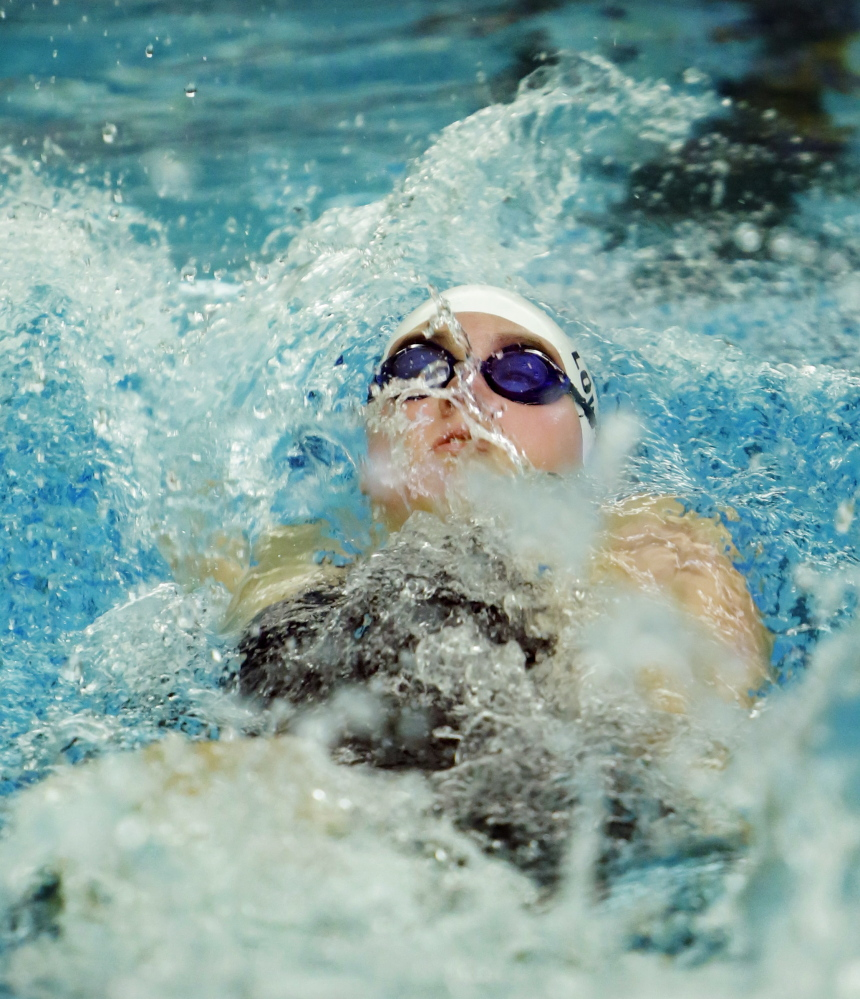 Marshall Lowery of Kennebunk swims the backstroke portion of the 200 individual medley. Lowery captured the event with a time of 2 minutes, 13.04 seconds.