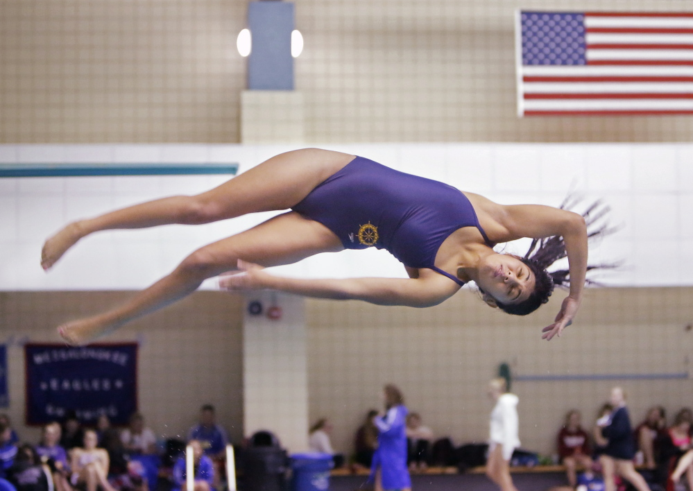Three years, three state diving championships for junior Charlotte Janelle of Falmouth, who fell short of her personal goal of 415 points, which would have been a pool record at Bowdoin College, but her score of 395.25 was far in front of anyone else.