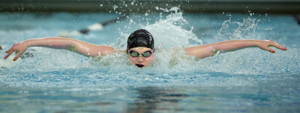 Brunswick sophomore Caitlin Tycz heads toward a victory in the 100-yard butterfly Tuesday at the Class A girls' swimming and diving championships at Bowdoin College. Tycz also helped the Dragons win both freestyle relays on the way to their first state championship since 2001.