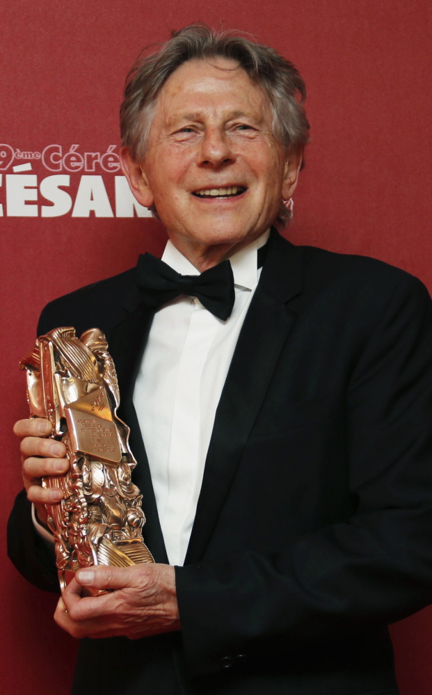 "Roman Polanski poses with his Best Director award for ""La Venus A La Fourrure"" at the Cesar Awards in Paris last year."