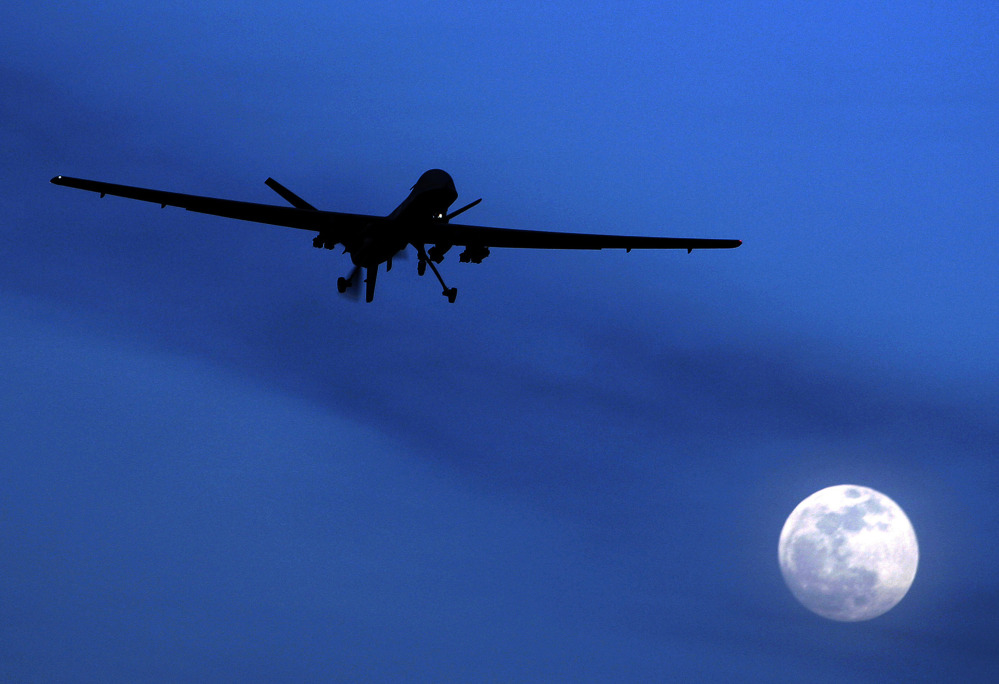 An unmanned U.S. Predator drone flies over southern Afghanistan.  The Associated Press