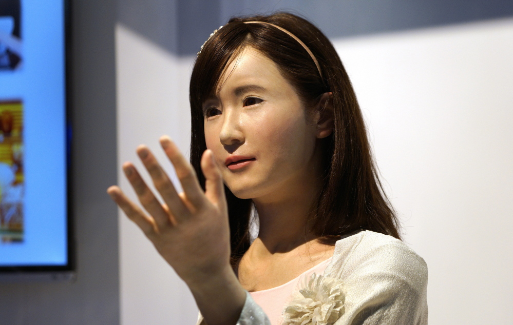 ChihiraAico, a communication android robot, gestures to visitors at the Toshiba booth at the International Consumer Electronics show  in Las Vegas  last month. More sophisticated machines can leave humans worse off, researchers say.
