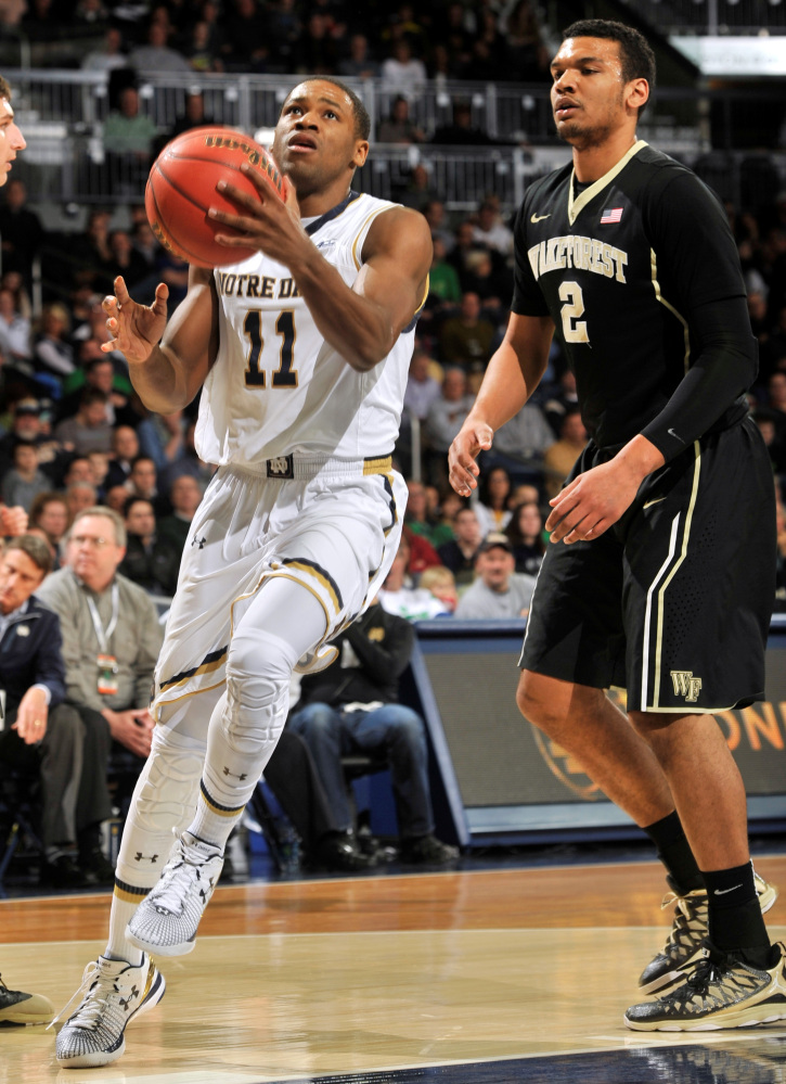 Notre Dame guard Demetrius Jackson (11) drives the lane as Wake Forest forward Devin Thomas (2) defends in the first half of an NCAA college basketball game Tuesday, Feb. 17, 2015, in South Bend, Ind. (AP Photo/Joe Raymond)