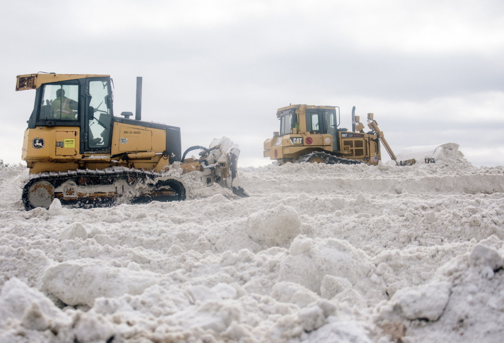 Portland workers keep the pile of dumped snow near the jetport at 40 feet or below so they can operate large machinery on it without exceeding the FAA height limit.