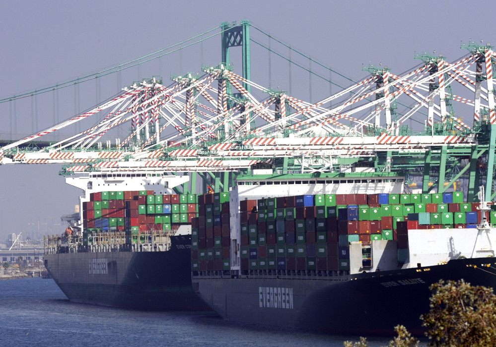 Freighters and cargo containers sit idle at the Port of Los Angeles as a backlog of over 30 container ships sit anchored outside the port on Wednesday. U.S. Labor Secretary Tom Perez planned to hold a second round of talks with shipping company executives and union leaders for 20,000 dock workers on Wednesday, seeking to broker a deal to end months of labor turmoil clogging cargo traffic at 29 West Coast ports.