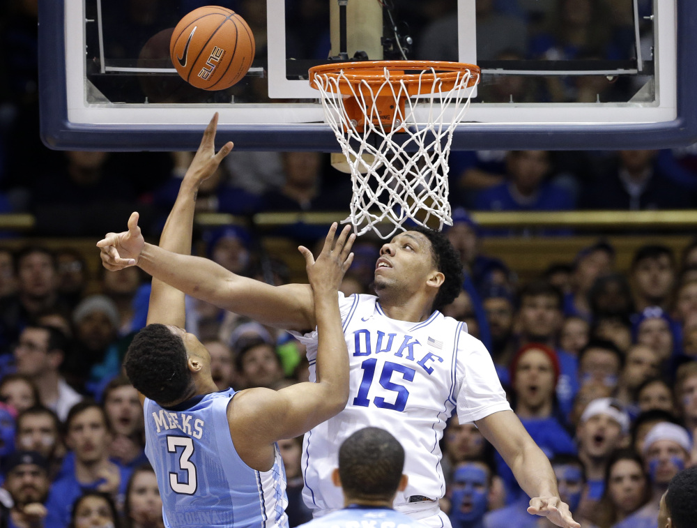 Duke's Jahlil Okafor defends North Carolina's Kennedy Meeks in the first half of Wednesday night's game at Durham, N.C. Duke rallied to beat North Carolina in overtime, 92-90.
