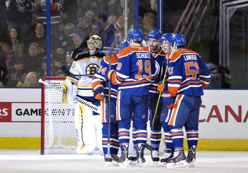 Boston Bruins goalie Tuukka Rask looks on as the Edmonton Oilers celebrate a goal during the first period of Wednesday night's game in Edmonton, Alberta.