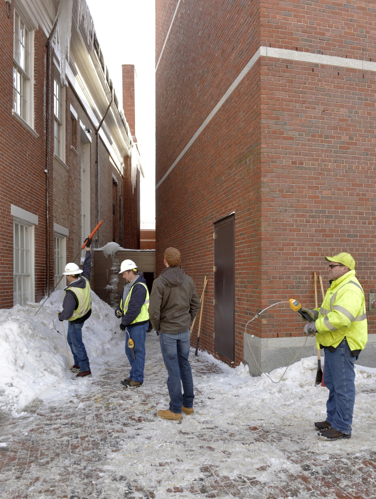 Unitil Gas Company crews check for gas fumes in the area near the Portland Museum of Art. A large icicle fell from the roof of the Children's Museum and Theatre of Maine and punctured a gas line into the art museum.