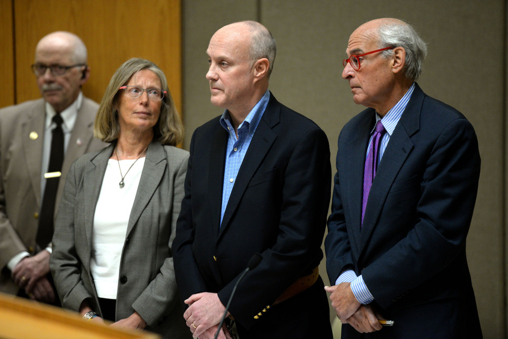 Robert Dellinger stands between his attorneys Lucy Karl and Steven Gordon in Grafton County Superior Court in North Haverhill, N.H., on Thursday.