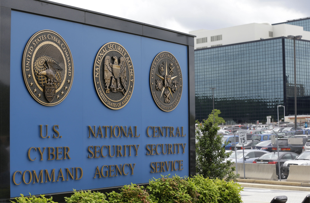 FILE - In this June 6, 2013, file photo, a sign stands outside the National Security Administration (NSA) campus in Fort Meade, Md. Britain's electronic spying agency, in cooperation with the NSA, hacked into the networks of a Dutch company to steal codes that allow both governments to seamlessly eavesdrop on mobile phones worldwide, according to the documents given to journalists by Edward Snowden. (AP Photo/Patrick Semansky, File)