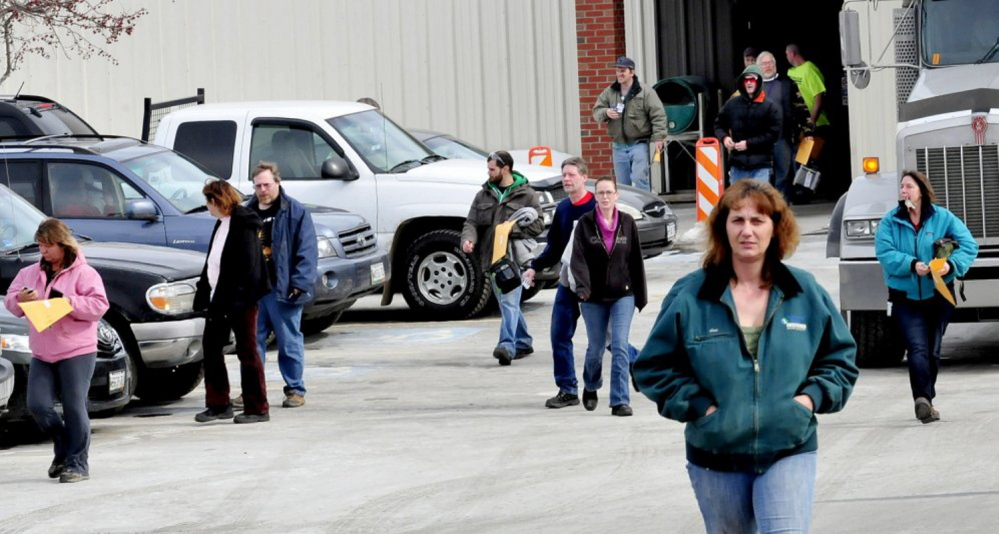 Employees leave UTC Fire & Security in Pittsfield last March after hearing that the company would close this winter. Company officials say it will be a few weeks before all activities at the plant are wound down.