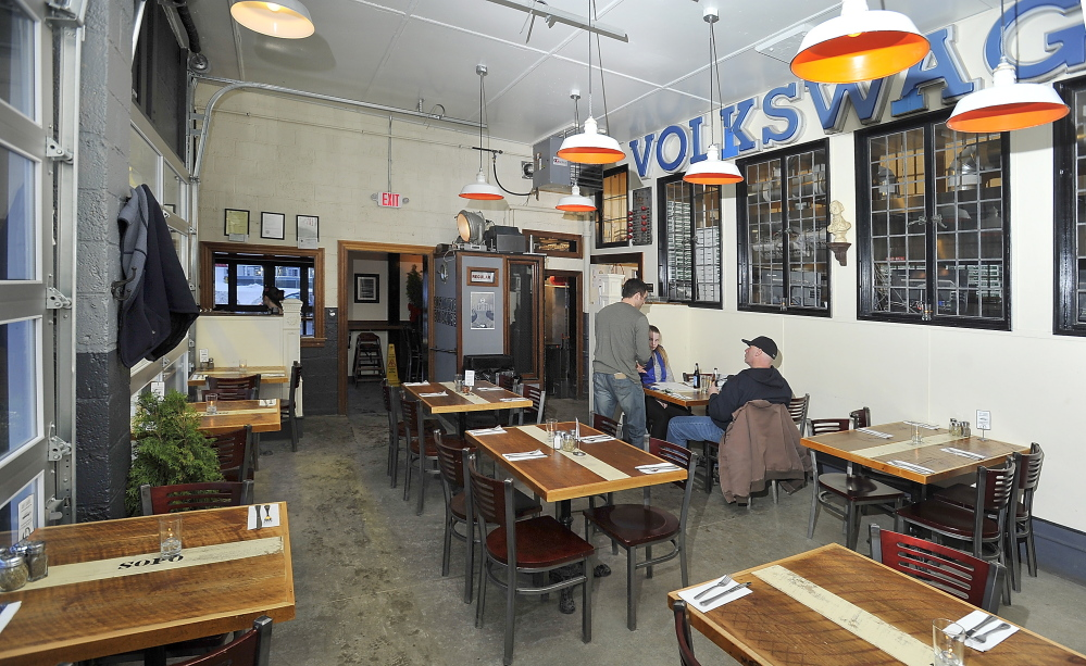 The interior at Otto in South Portland reflects the building's former life as a gas station.
