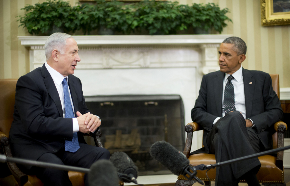 President Obama meets with Israeli Prime Minister Benjamin Netanyahu in the Oval Office in October. The two won't be meeting when Netanyahu visits in March, weeks before Israeli elections.