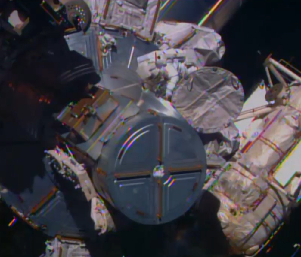 In this image from television, astronaut ButchWilmore begins the spacewalk Saturday morning to wire the International Space Station in preparation for the arrival in July of the international docking port for the Boeing and Space-X commercial crew vehicles.